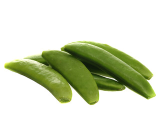 Pile of snap peas or mange-tout islated on white background