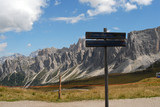 Landscape view of Dolomites mountain with sign post