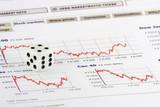 White dice over stock market graphs poster