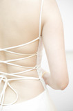 Soft focus on back of the wedding dress poster