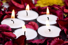 row of candles with red rose petals (shallow DOF)