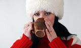 young girl in fluffy hat with hot drink poster