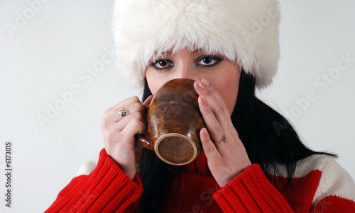 poster of young girl in fluffy hat with hot drink