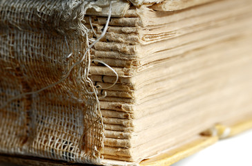Close-up photo of the destroyed binding of old book