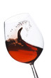Isolated moving (motion blur) red wine glass