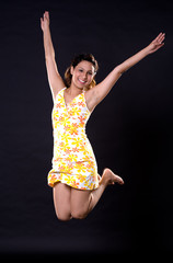 woman jumping happily