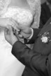 The groom puts on a wedding ring to finger of the beloved