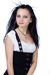 Young beautiful gothic girl with red cross isolated on white