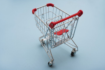 Empty Shopping Cart on a light blue background