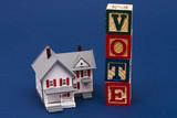 House with alphabet block spelling vote poster
