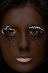 closeup portrait of young woman with extreme makeup