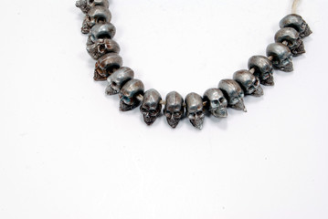 pewter skulls on string