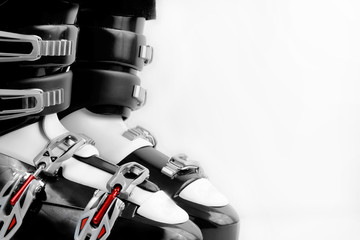 black and red ski boots over white background