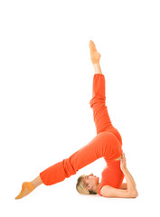 Beautiful young woman doing supported shoulderstand