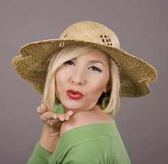 Blonde Straw Hat Blowing Kiss