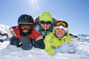 Happy group of people on a background of the blue sky and a snow