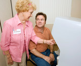 Voter receiving instructions on using a new voting machine poster