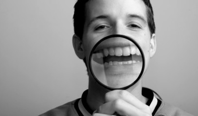 Psychology fun concept.  Man and magnifier on his smile