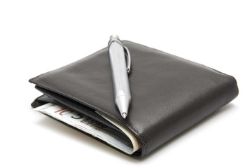 Silver pen on wallet with eouro money