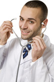 healthcare and medicine: young doctor using a stethoscope poster