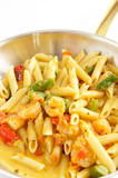 Shrimp Penne Pasta cooked in a stainless steel frying pan poster