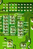 Close-up of micro circuit, resistors and chip of a motherboard poster