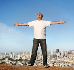A man standing on a hill with a view of San Francisco