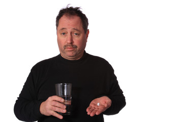 Man taking two pills on a White Background.