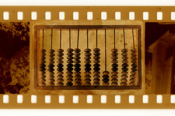 oldies 35mm frame photo with vintage wooden abacus