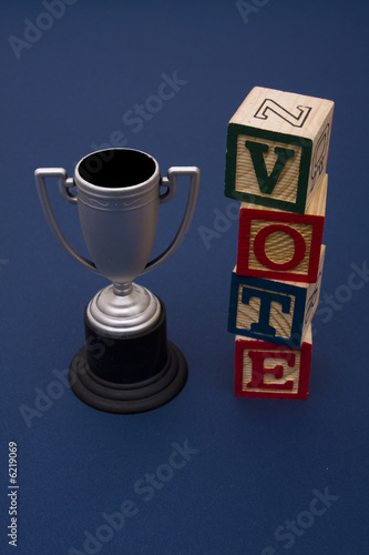 Trophy with vote alphabet blocks