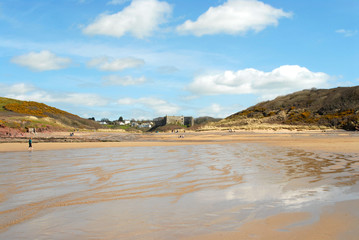 Wales - sandy, wild and empty beach with castle