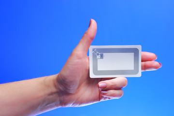 woman holding Radio-frequency identification (RFID) tag card