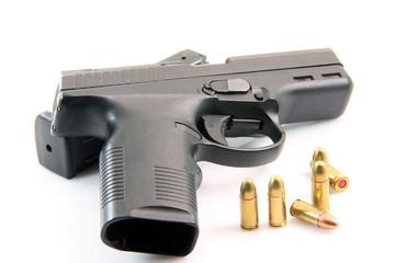 ammunition and automatic handgun isolated