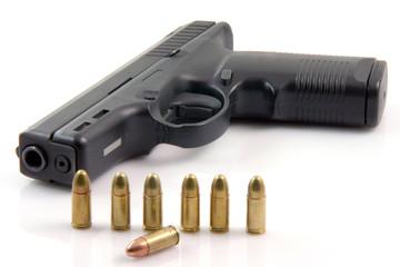 ammunition and automatic handgun isolated on white background