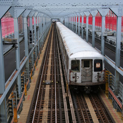 subway trains on Williamsburg Bridge New York