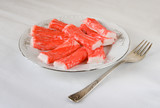 Chunks of red-white crab meat (imitation), light background poster