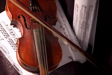 Old violin with composition of music notes