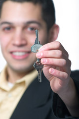 Successful young man with keys