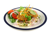 Carrot And tuna patties on a herbed potato stack with salad. poster