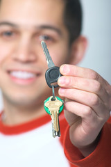 Young Man Handing Keys