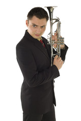 Man in suit holding a trumpet and posing.