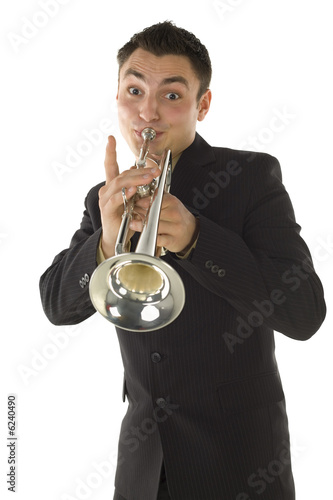 Man in suit standing and trumpet melody.