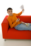 Trumpeter sitting on red couch and composing music