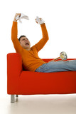 Furious trumpeter sitting on red couch and screaming