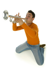 Man in orange blouse kneeling and trumpet. High angle view.