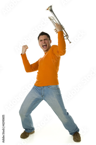 Screaming man in orange blouse standing with trumpet in hands.