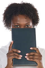 African american woman with book in her face