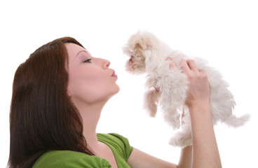 A pretty woman showing love (kissing) to her dog