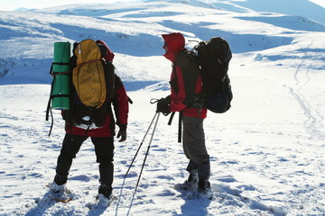 Backpackers in winter mountain