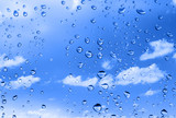 water drops against bright summer sky with cumulus clouds poster